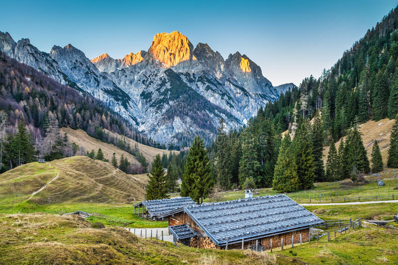 Beautiful landscape in the Alps with traditional mountain chalets. And glowing summits in beautiful evening light, Nationalpark Berchtesgadener Land, Bavaria stock image