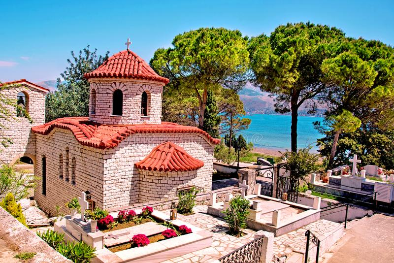 Beautiful landscape with an ancient church at the cemetery near the sea in Argostoli, Kefalonia, Greece. Stunning amazing. Charming places. prominent tourist stock photos