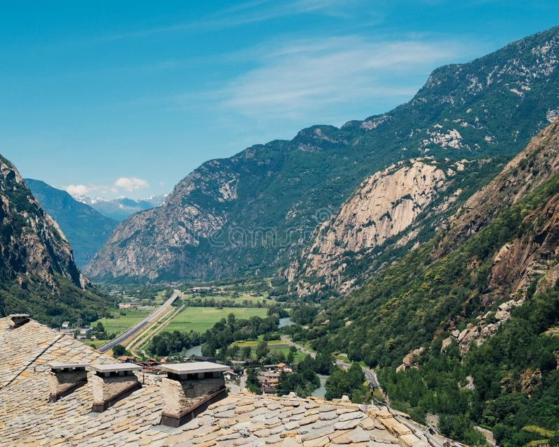 Beautiful landscape in the Aosta Valley mountainous region in northwestern Italy. Alpine valley in summer seen from fort Bard. royalty free stock photography