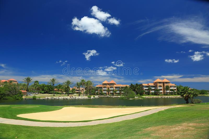 Beautiful landscape on Aruba Island. Blue sky and white clouds. Golf field. Beautiful background stock images