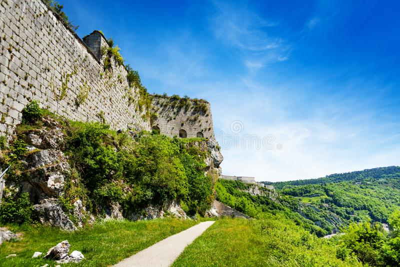Defensive wall of citadel in Besancon, France. Beautiful landscape of Besancon with defensive wall of citadel at sunny day royalty free stock images