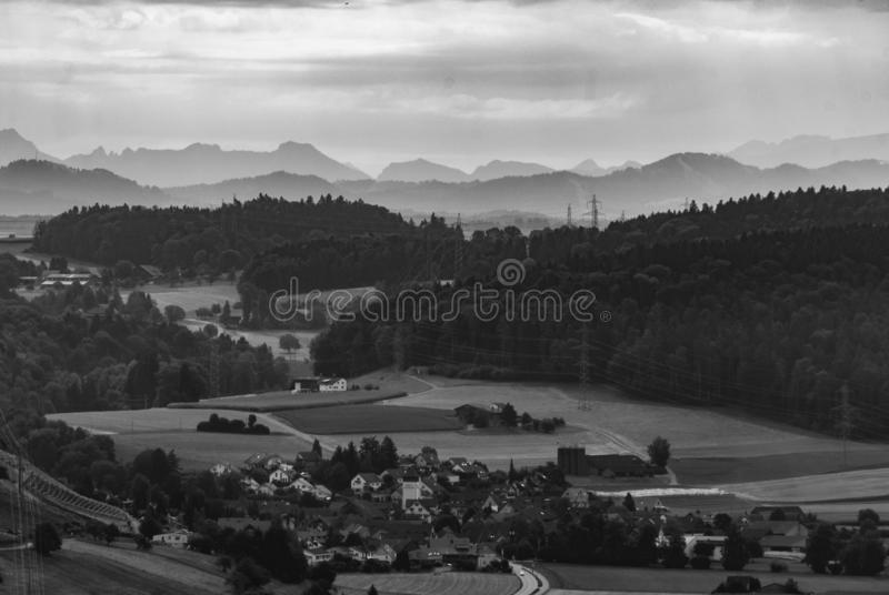 Beautiful landscape in black and white. Contrast, shadows, spectar, trees, village, country, countryside, road, leadingline, houses, hills, mountain, mountains stock photography