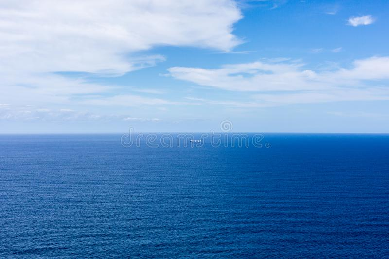 Blue ocean and sky, a boat royalty free stock images