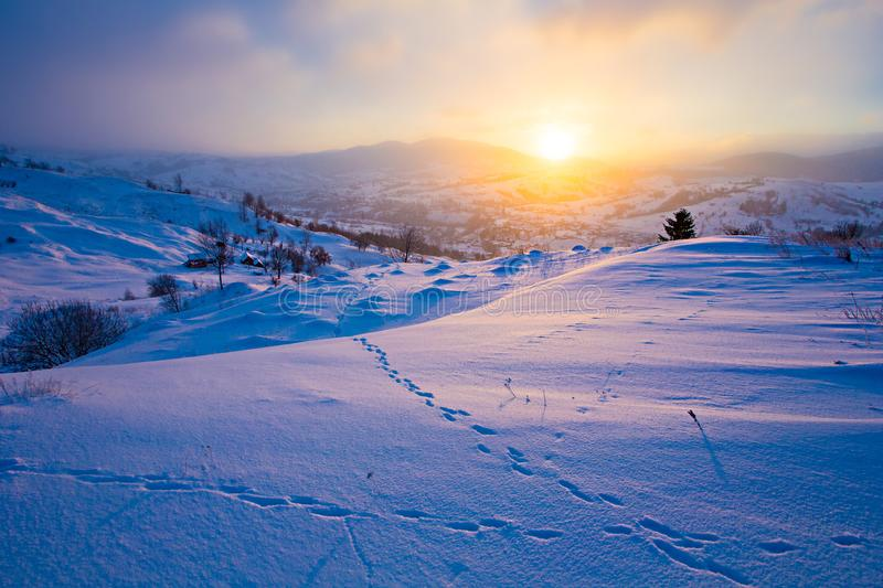 Beautiful landscape. Bright sun rising above mountains. Winter concept royalty free stock photos