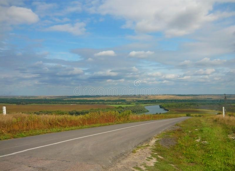 Beautiful landscape with clouds, river and road. Very beautiful landscape with clouds, river  and road. Beautiful blue sky. Romantic view. Interesting photo royalty free stock photos