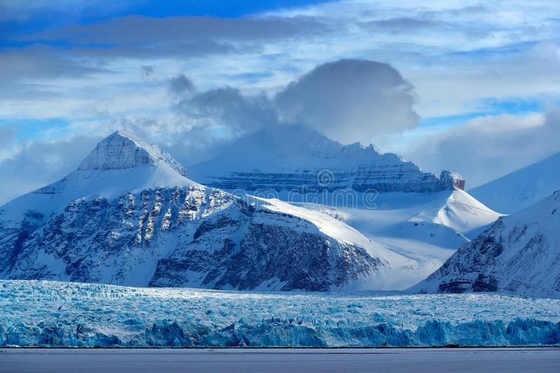 Beautiful landscape. Cold sea water. Land of ice. Travelling in Arctic Norway. White snowy mountain, blue glacier Svalbard, Norway. Europe royalty free stock photo