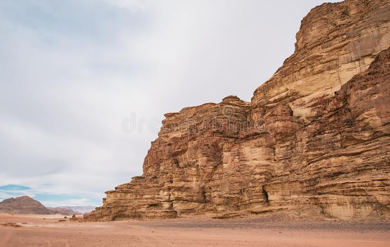 Beautiful landscape consisting of rocky mountains in the middle of the Wadi Rum desert in Jordan stock image