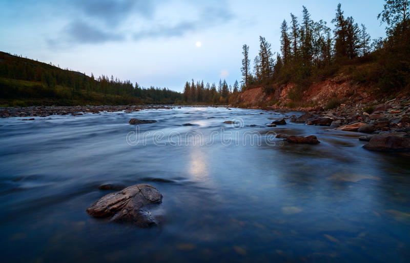 Beautiful landscape dawn Mountain river water close-ups long exposure moon royalty free stock images
