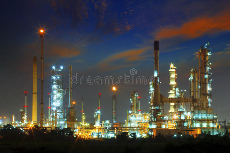 beautiful landscape dusky sky of heavy industry oil refinery plant with dazzled lighting stock photos
