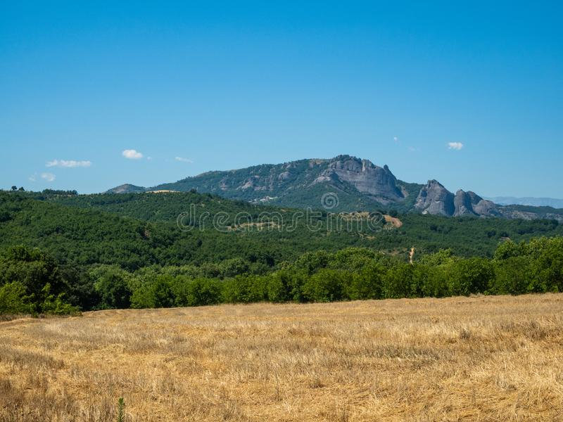 Beautiful landscape with fields, forests and mountains in Greece stock images