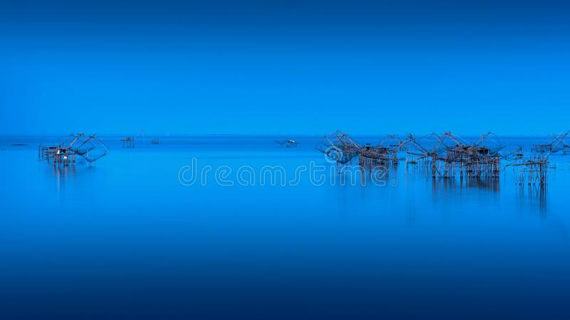 Beautiful landscape and fishing dip nets at Pakpra in Phatthalung, Thailand. stock photos