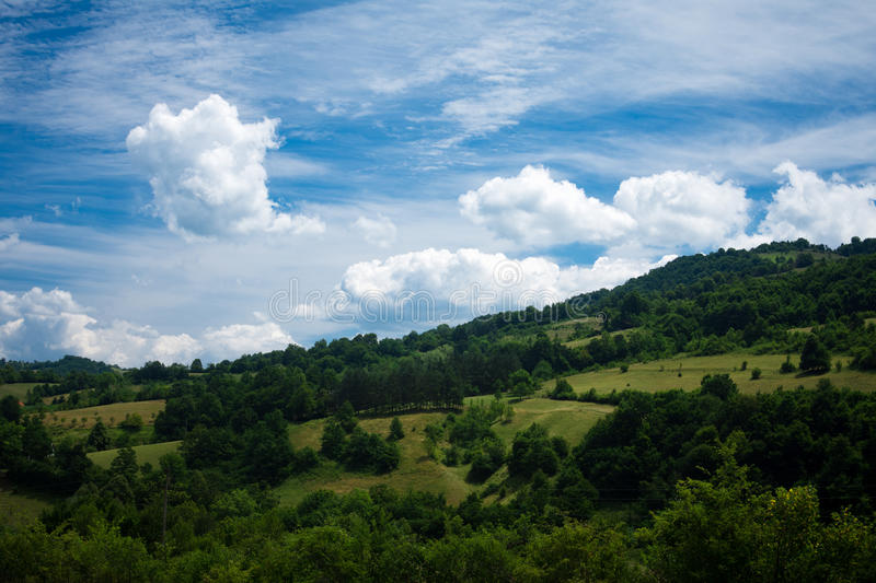 Beautiful landscape with hill and clouds stock photos
