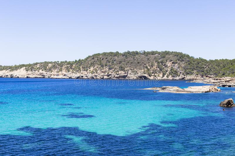 Beautiful landscape in Ibiza of blue ocean in a sunny day with boats in the horizon. Summer and holidays concept. Isle, water, scenic, spanish, sea, sky stock photo