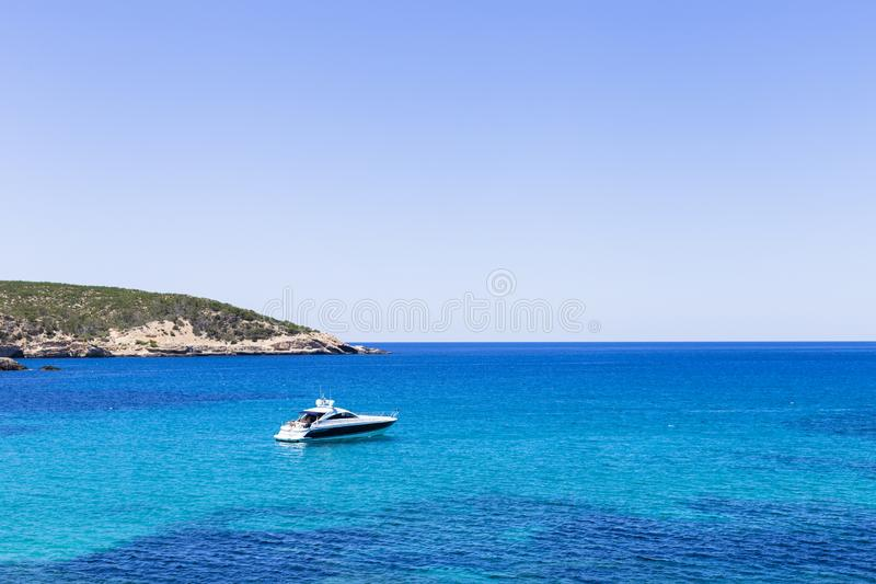 Beautiful landscape in Ibiza of blue ocean in a sunny day with boats in the horizon. Summer and holidays concept. Isle, water, scenic, spanish, sea, sky royalty free stock images