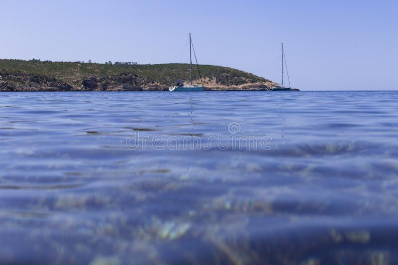 Beautiful landscape in Ibiza of blue ocean in a sunny day with boats in the horizon. Summer and holidays concept. Isle, water, scenic, spanish, sea, sky royalty free stock photo