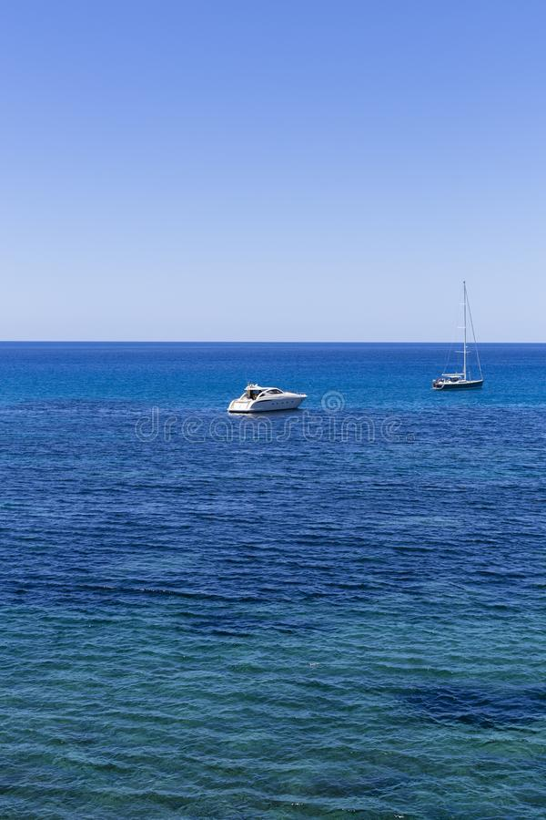 Beautiful landscape in Ibiza of blue ocean in a sunny day with boats in the horizon. Summer and holidays concept. Isle, water, scenic, spanish, sea, sky royalty free stock photography