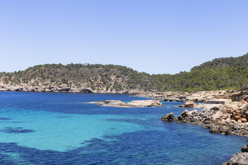 Beautiful landscape in Ibiza of blue ocean in a sunny day with boats in the horizon. Summer and holidays concept. Isle, water, scenic, spanish, sea, sky stock images