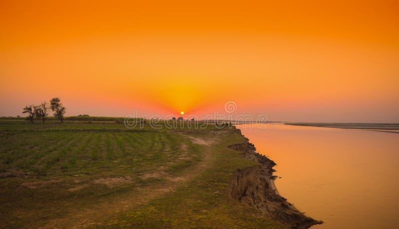 Beautiful landscape image of sunset on river indus stock photos