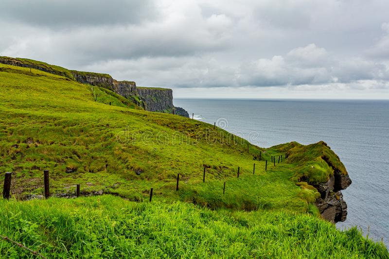Beautiful landscape of the Irish countryside, cliffs and the sea along the coastal walk route. From Doolin to the Cliffs of Moher, Wild Atlantic Way, county stock image