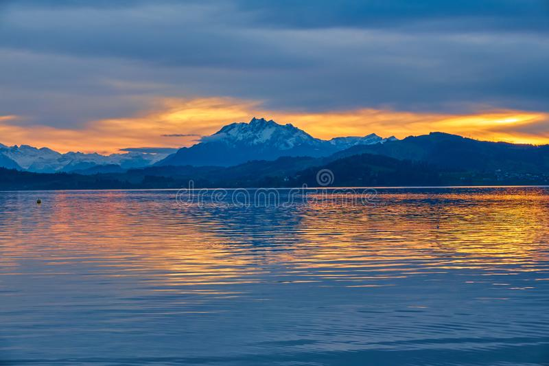 Beautiful landscape with a lake surrounded by high mountains and a cloudy sky at sunset, Switzerland, Lake Zug stock photo