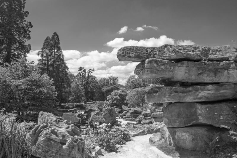 Beautiful landscape of large rock boulders with a dramatic sky background in black and white stock photography