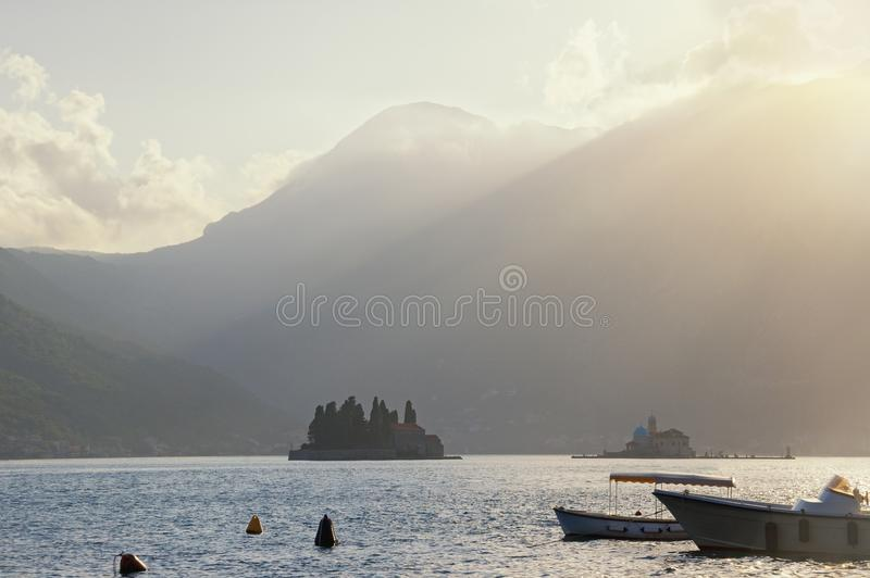 Beautiful landscape with last rays of setting sun. Montenegro, Bay of Kotor, Perast stock photo