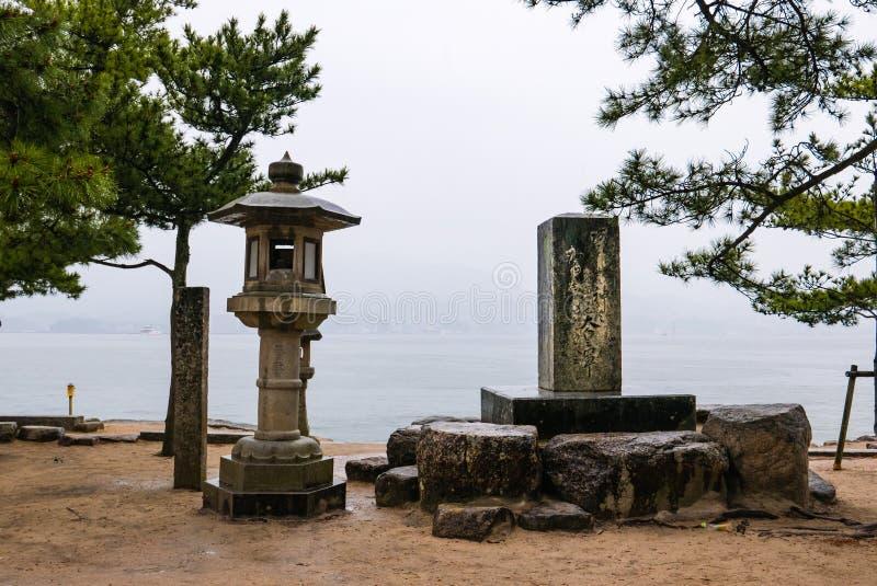 Beautiful landscape of Miyajima island. Miyajima, Japan - May 6, 2016: Beautiful landscape of Miyajima island with stone lantern and pine tree royalty free stock images