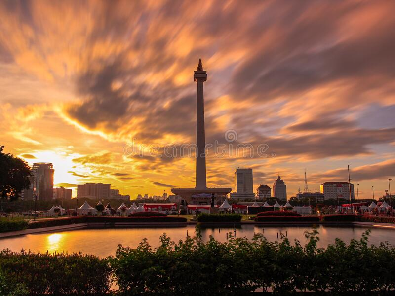 Beautiful landscape of Monas Monument in Medan Merdeka Square, Jakarta in the cloudy sunset. In long exposure photography mode royalty free stock photo
