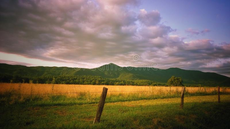 Beautiful landscape with mountain range in Tennessee.  Sunlit grass with mountain range stock photo