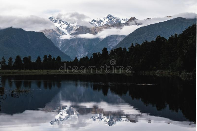 Beautiful landscape of the mountain and the reflection on the lake. Lake Matheson, Fox Glacier, New Zealand stock images