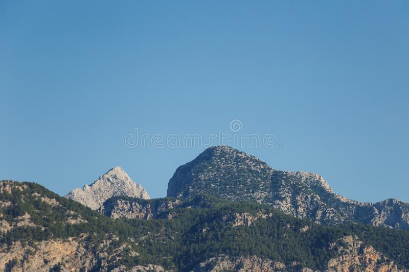 Beautiful landscape in the mountain view. Beautiful view of the Taurus mountains in the morning sun against the blue sky. Kemer, Turkey royalty free stock photography