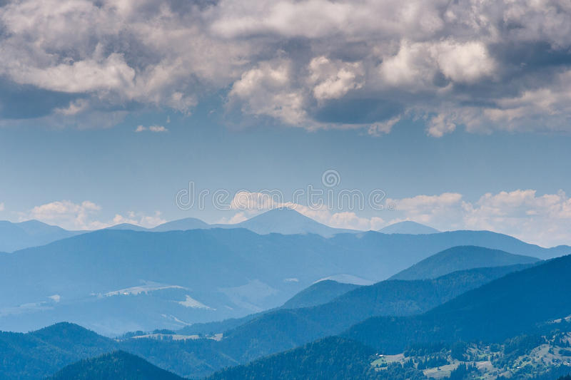 Beautiful landscape of mountains in the misty haze. royalty free stock photography