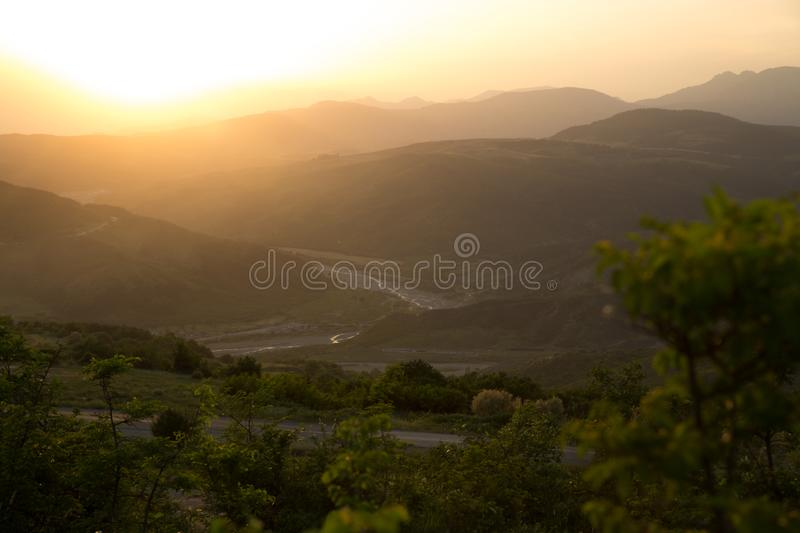 Beautiful landscape in the mountains with the sun at dawn. Mountains at the sunset time. Azerbaijan Caucasus Mountains. Agsu pass. Baskal. Nature stock photos