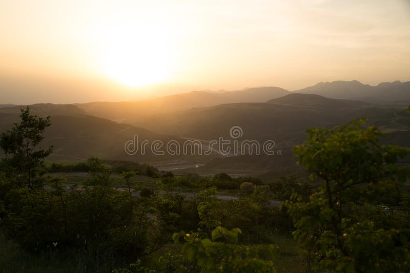 Beautiful landscape in the mountains with the sun at dawn. Mountains at the sunset time. Azerbaijan Caucasus Mountains. Agsu pass. Baskal. Nature stock photography