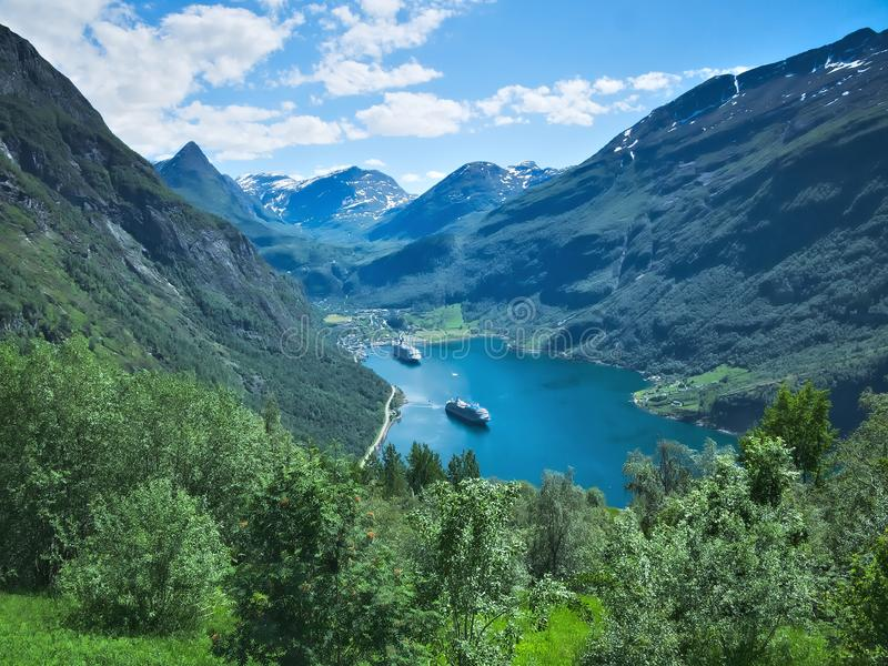 Beautiful landscape in Norway includes Geiranger fjord, mountains and ships royalty free stock photos