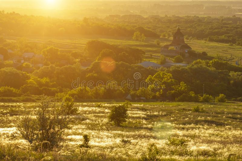 The beautiful landscape of the old Church in the beams of the setting or rising sun soft focus.  stock photography
