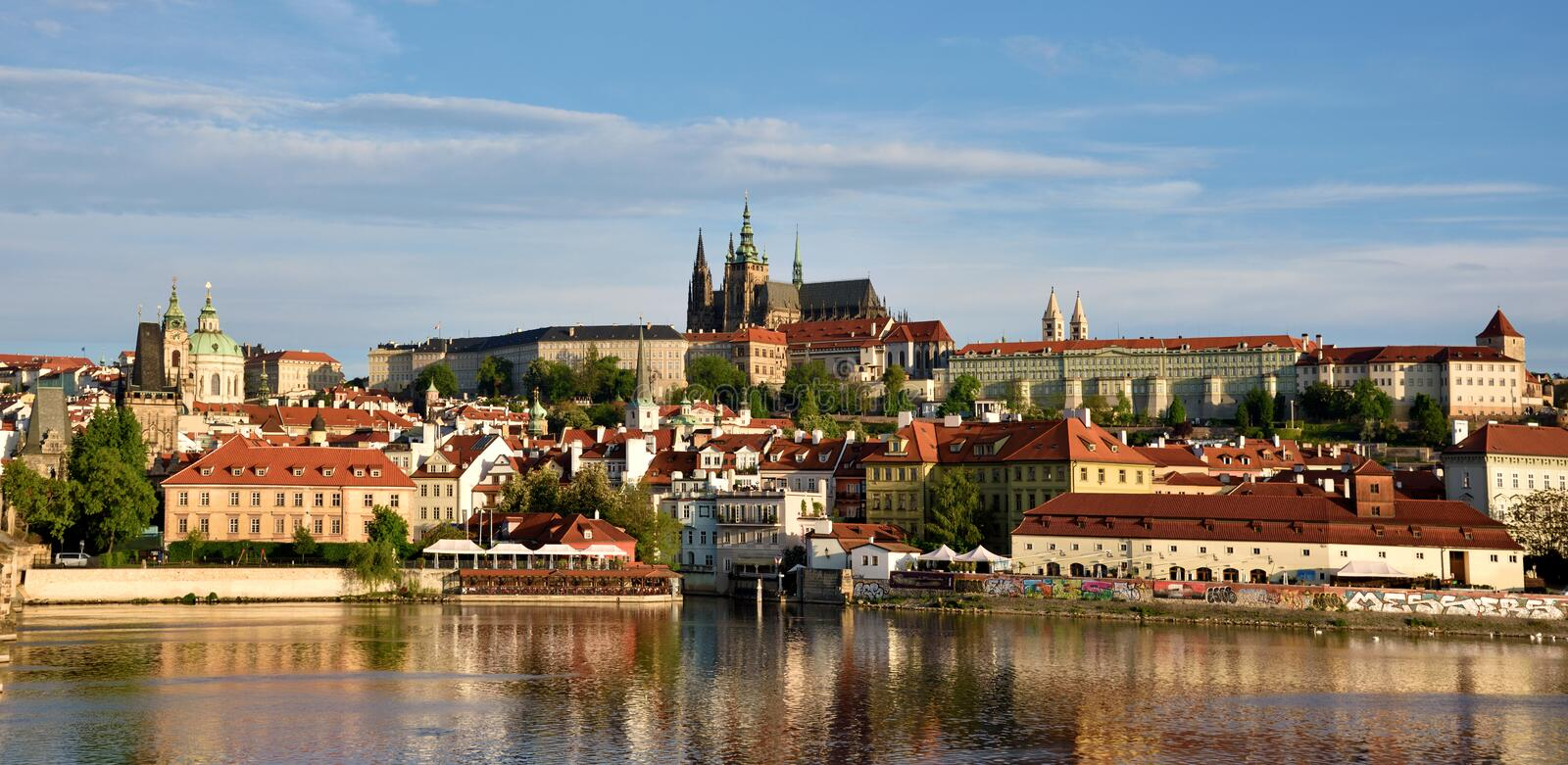 The beautiful landscape of the old town and the Hradcany (Prague Castle) with St. Vitus Cathedral and St. George church in Prague stock photography