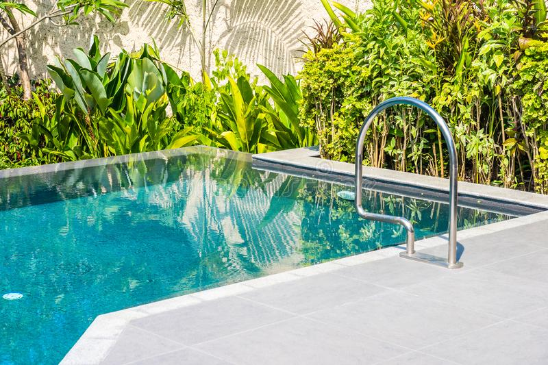 Beautiful landscape outdoor swimming pool in hotel and resort for leisure. Vacation and travel royalty free stock images