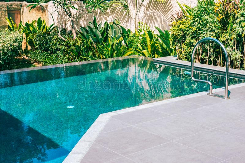 Beautiful landscape outdoor swimming pool in hotel and resort for leisure. Vacation and travel royalty free stock photography