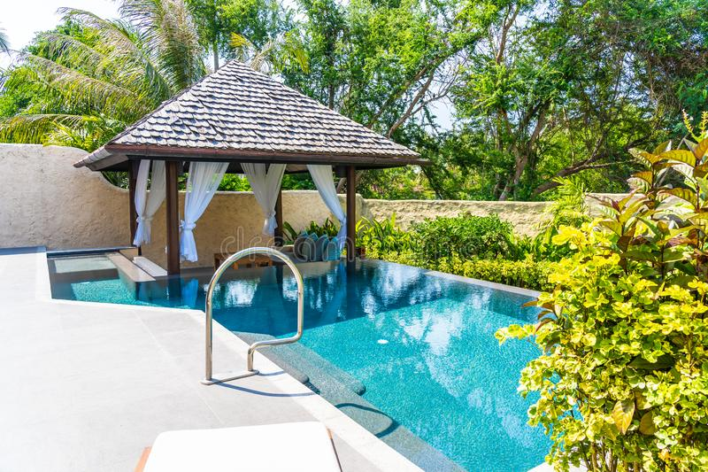 Beautiful landscape outdoor swimming pool in hotel and resort for leisure. Vacation and travel stock image