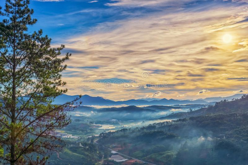 Beautiful landscape of overcast morning at misty layered mountains stock photo