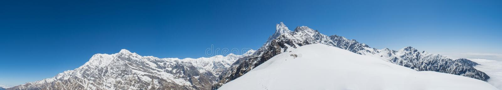 Beautiful landscape panorama view of Himalaya mountains covered with snow at Mardi Himal trekking area. In Nepal stock photography