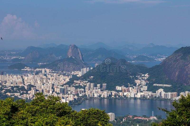 Beautiful landscape with rainforest, city district Leblon, Ipanema, Botafogo, Lagoon Rodrigo de Freitas and mountains. Corcovado, sugarloaf, two brothers seen stock image