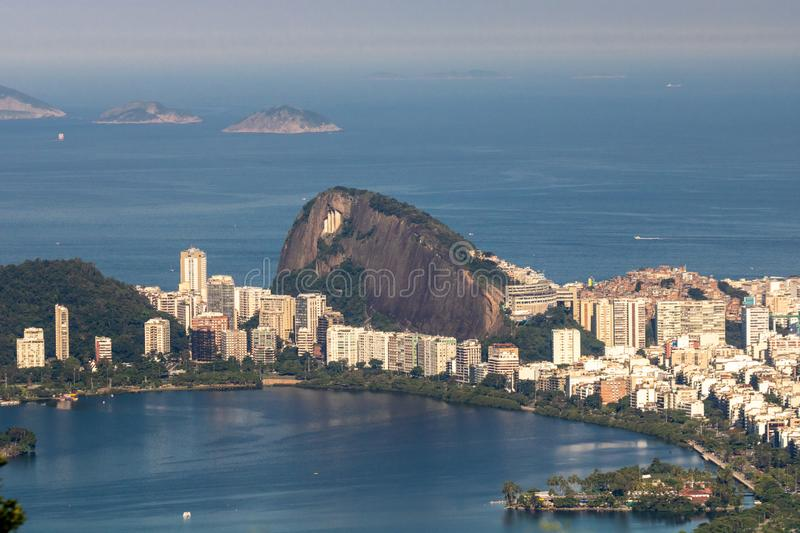Beautiful landscape with rainforest, city district Leblon, Ipanema, Botafogo, Lagoon Rodrigo de Freitas and mountains. Corcovado, sugarloaf, two brothers seen royalty free stock photo