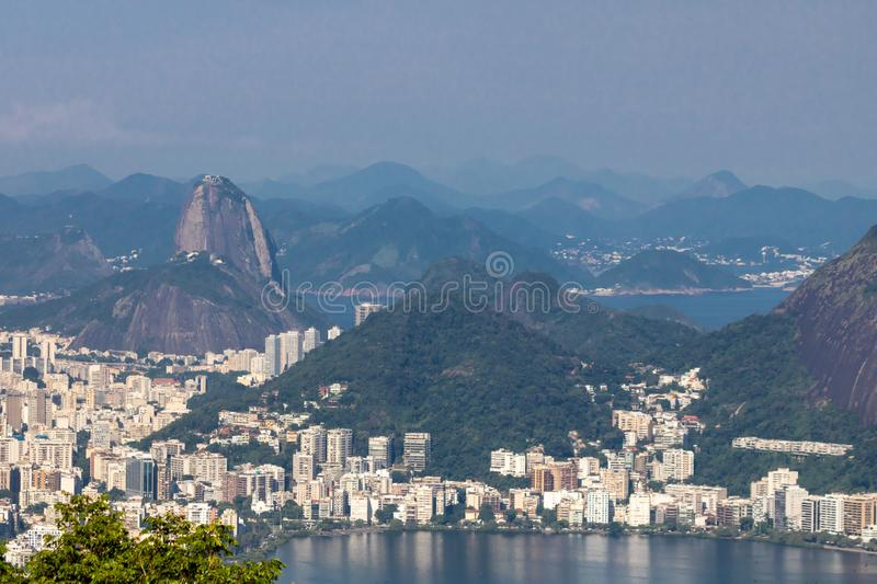 Beautiful landscape with rainforest, city district Leblon, Ipanema, Botafogo, Lagoon Rodrigo de Freitas and mountains. Corcovado, sugarloaf, two brothers seen royalty free stock photography