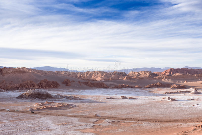 Beautiful landscape with red rocks, clouds and blue sky at Valle de La Luna during sunset royalty free stock photography