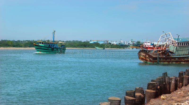 Beautiful landscape of the river arasalaru with old and new boats near karaikal beach. Beautiful landscape of the river arasalaru with old and new boats near stock images