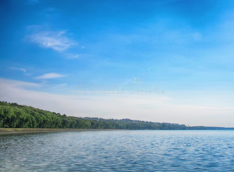 Beautiful landscape of the river Dnieper and blue sky. With green trees royalty free stock photo