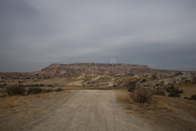 Beautiful landscape with road. On the horizon is a hill Aktepe from the mountain. Goreme region, Cappadocia, Anatolia, Turkey stock photos