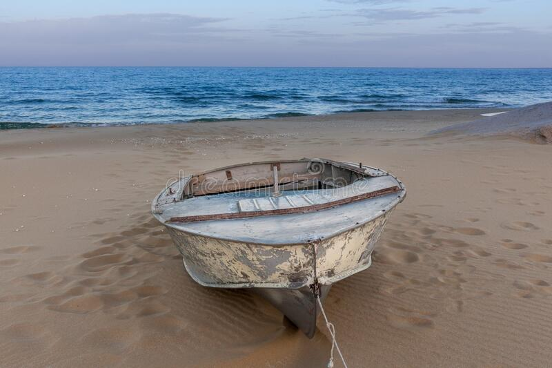 Beautiful landscape of rusty boat on the beach in sunrise. Vintage Boat in the seashore. Kazakstan, Caspian Sea. Beautiful landscape of rusty boat on the beach stock photography